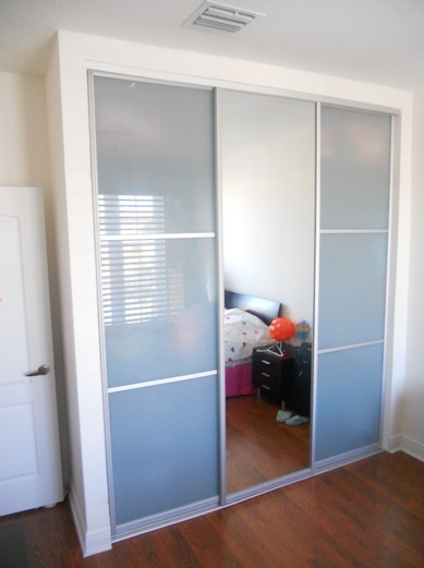 Bedroom with sliding frosted glass interior doors