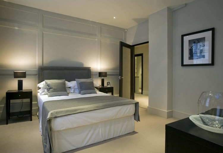 Contemporary bedroom with frosted glass interior doors