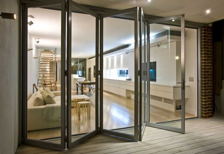 Modern living room with folding french doors | Home Doors ...
