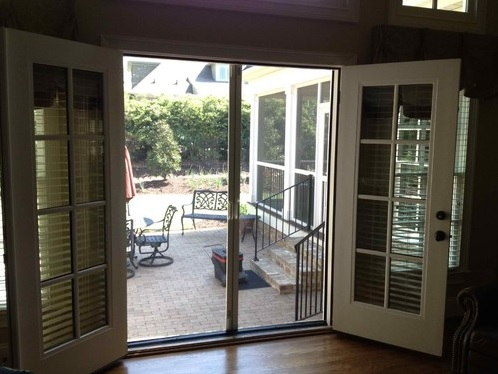 Double traditional screen doors for french doors