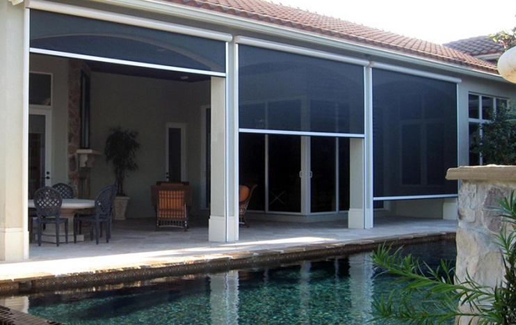 Motorized retractable garage door screen for patio