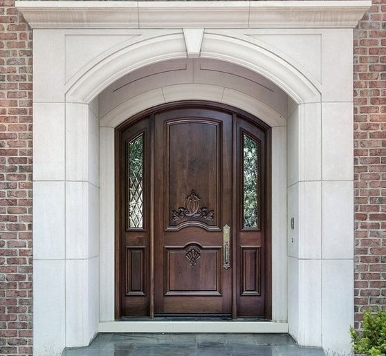 Arched entry doors with beautiful wood accents