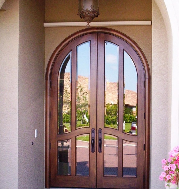 Arched entry doors with mirror inserts