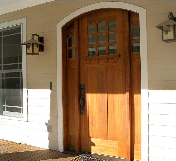 Arched front single door designs with natural wood finish