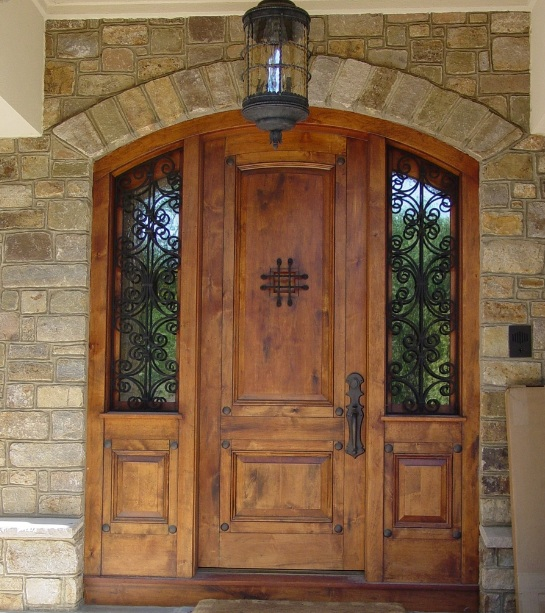 Custom entry doors with arched design