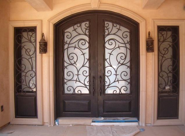 Custom iron entry doors with decorative iron panels