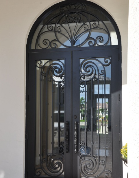 Custom iron entry doors with glass inserts