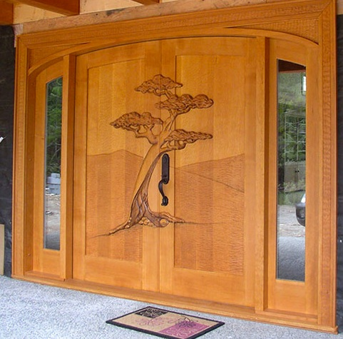 Custom wood entry doors with with tree accents