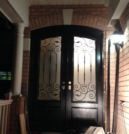 Fiberglass arched entry doors with decorative glass inserts