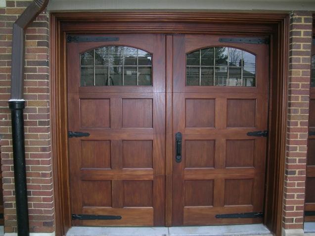 Custom mahogany double entry doors with window inserts