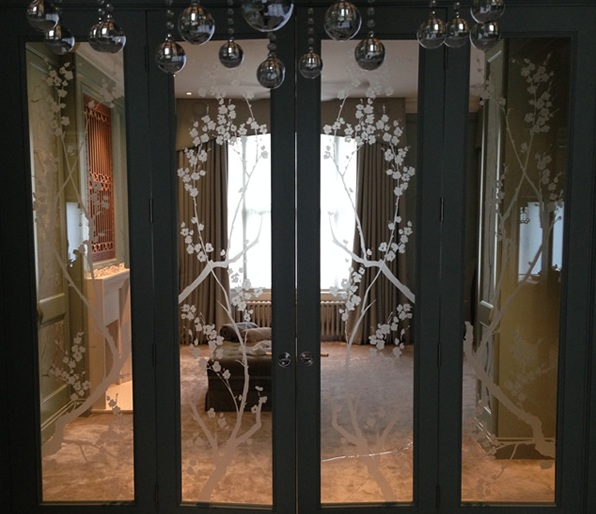 Etched glass interior doors with black wooden frame