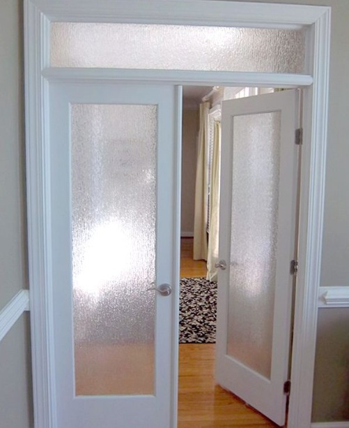 Interior door with frosted glass panel and top