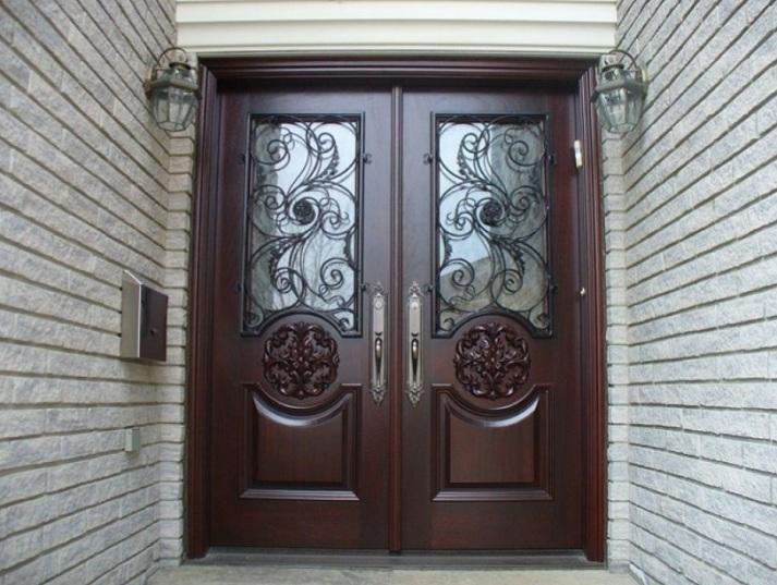 Mahogany double entry doors with decorative panels
