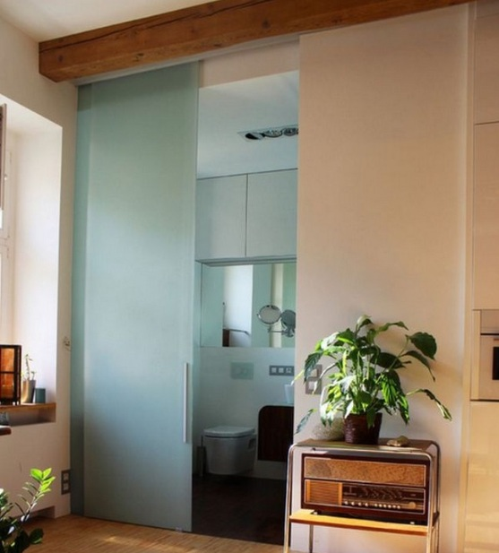 Sliding frosted glass interior bathroom doors with wooden toppers
