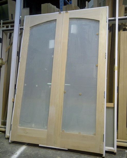 Unfinished interior french doors with frosted glass