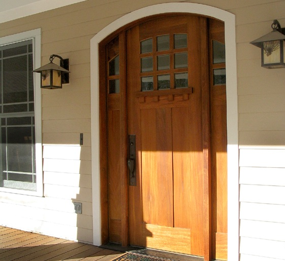 Craftsman style mahogany front door with sidelights