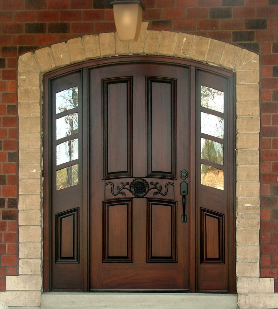 Mahogany front door with arched top