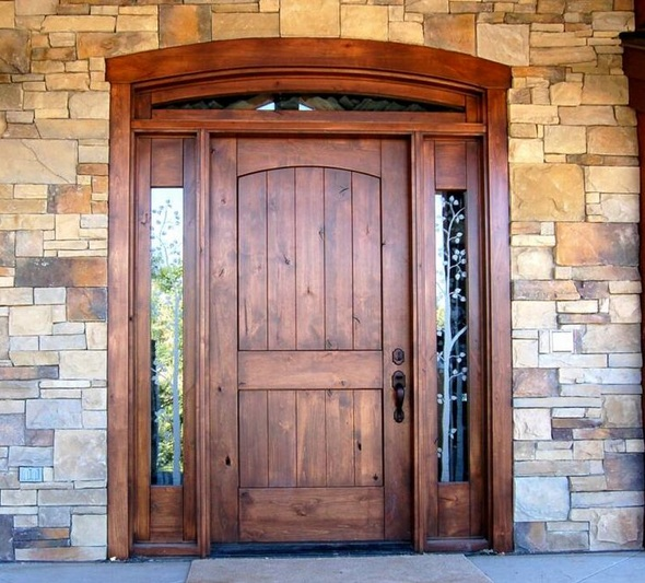 Rustic mahogany front door with sidelights
