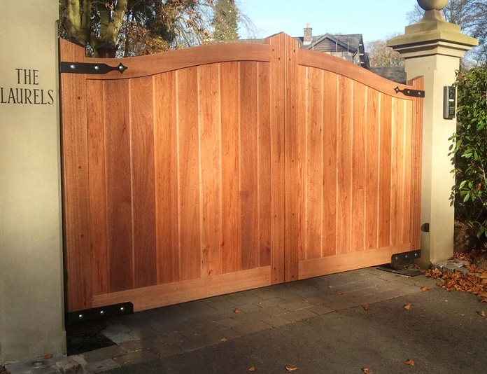 Main entrance gate design and material for enhancing your for Wooden main gate design